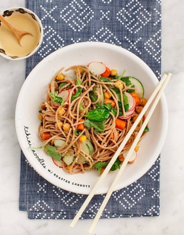 Tahini Noodle Salad with Roasted Carrots & Chickpeas in a bowl with chopsticks