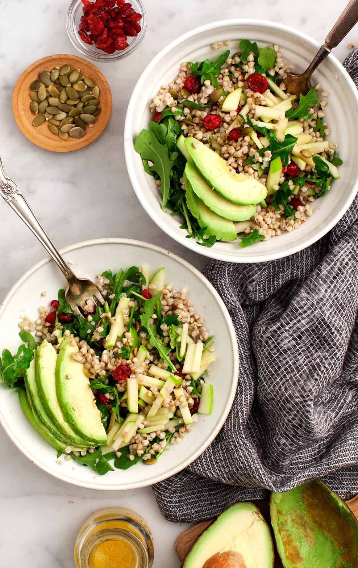 Buckwheat, Apple, Cranberry Avocado Salad in bowls with forks