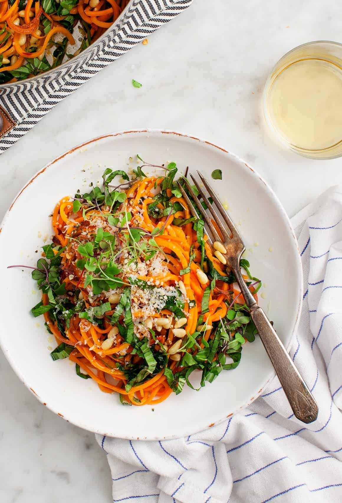 Sweet potato noodles with garlic kale recipe love and lemons sweet potato noodles with garlic kale on plate with a fork forumfinder Image collections
