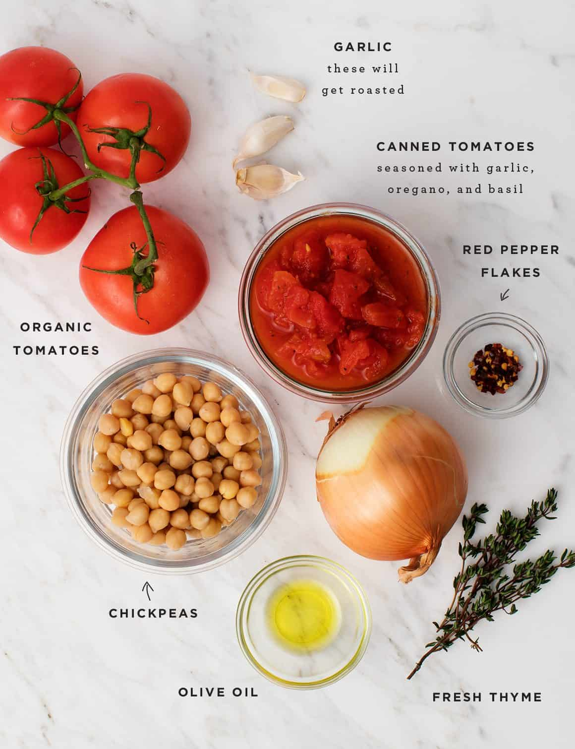 Homemade tomato soup recipe ingredients on marble