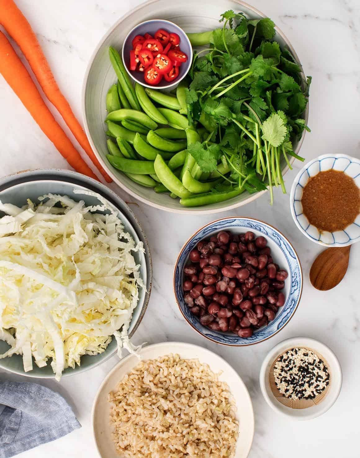 Adzuki beans, veggies, and rice in bowls