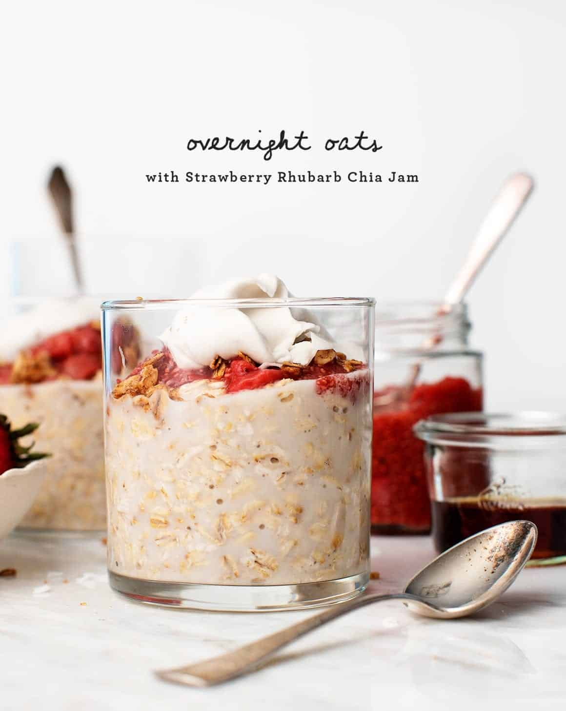Strawberry Rhubarb Chia Overnight Oat Parfaits in jars with spoons
