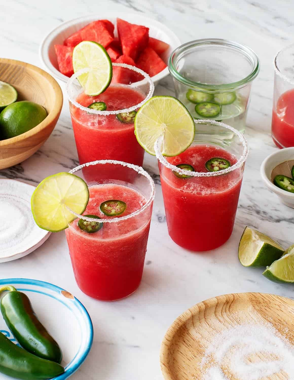 Spicy Watermelon Margaritas in glasses with lime slices