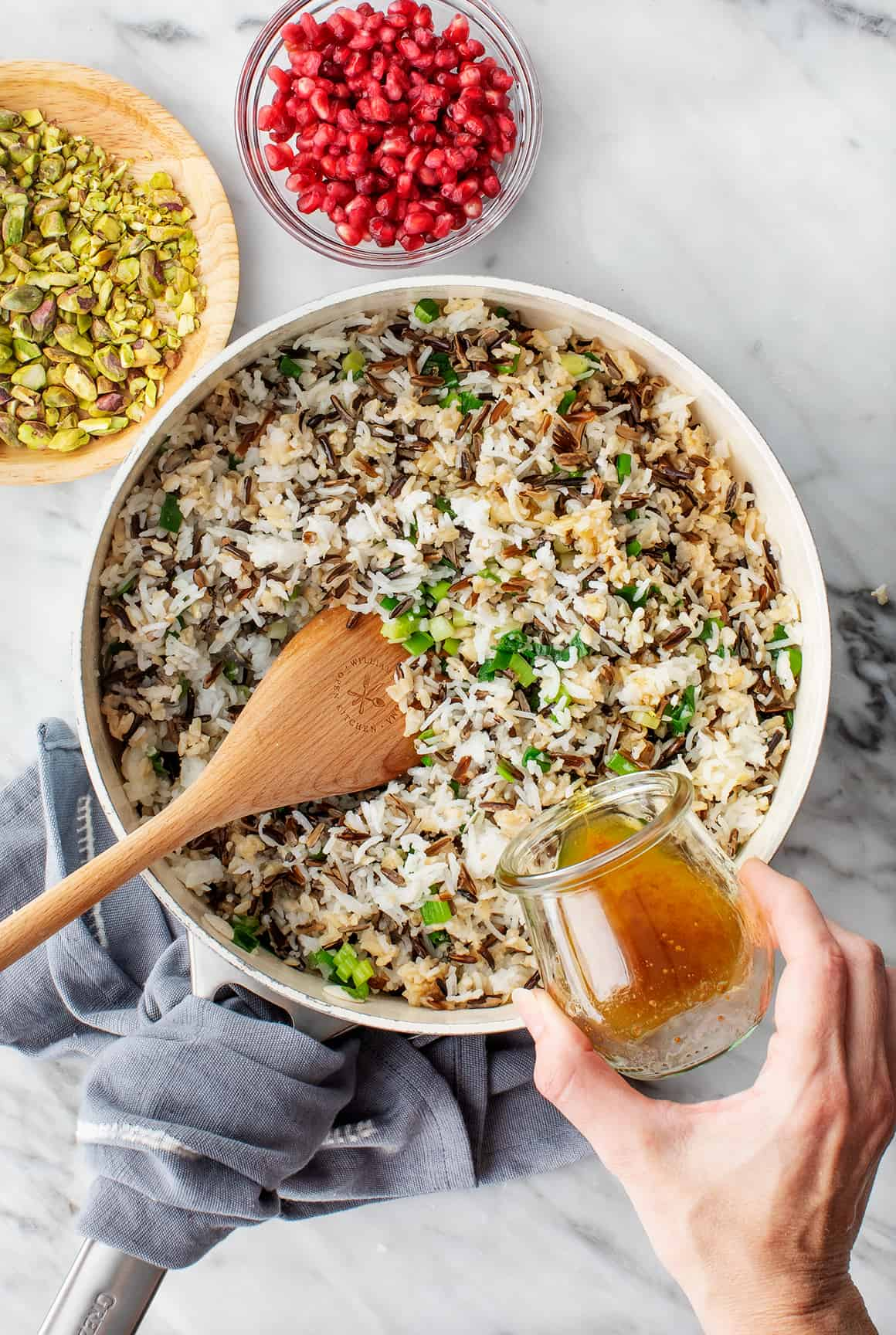 Wild and brown rice and scallions in a skillet