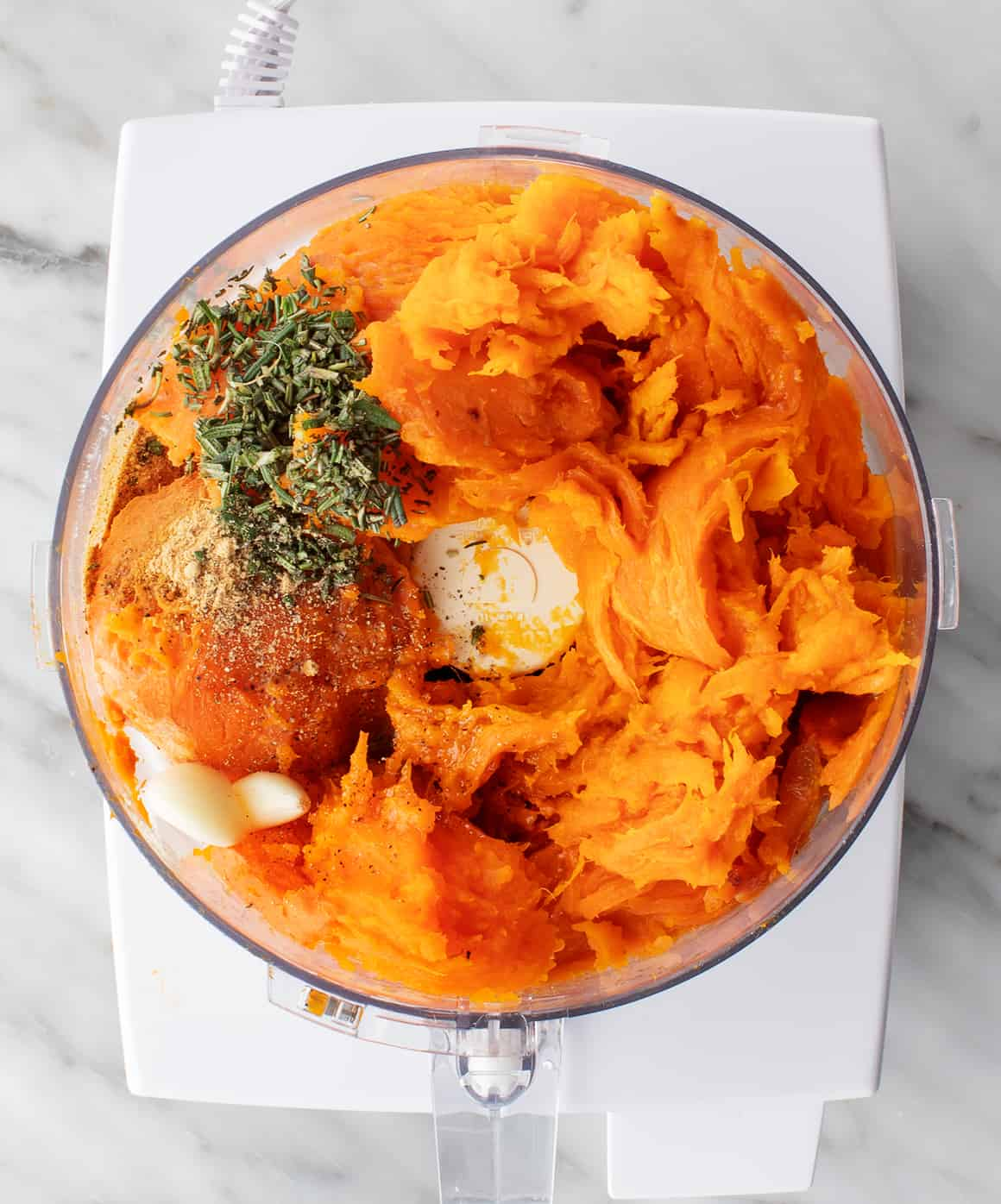 Baked sweet potato flesh and rosemary in a food processor