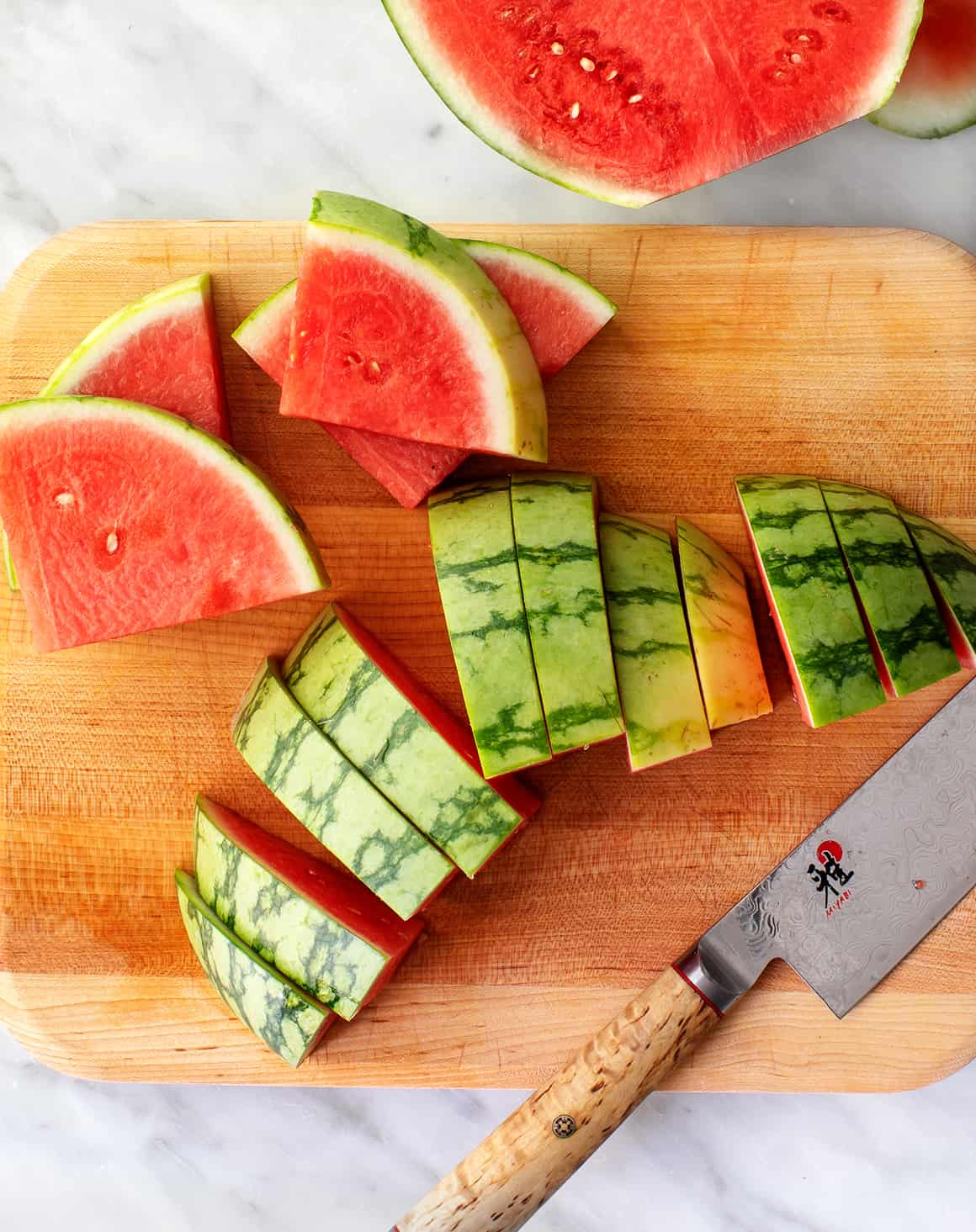 Best way to cut a watermelon - wedges on a cutting board with knife